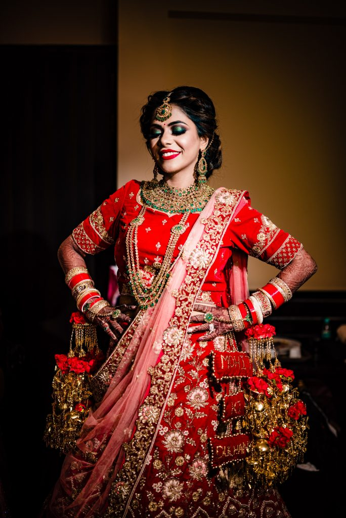 Red & Golden Bridal Lehenga worn by Bride for her destination wedding in Karjat