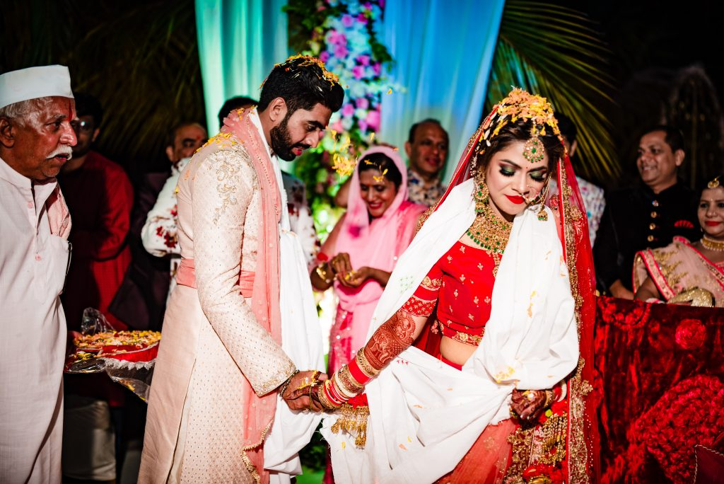 A candid captured from the pheras ceremony of this destination wedding at Karjat
