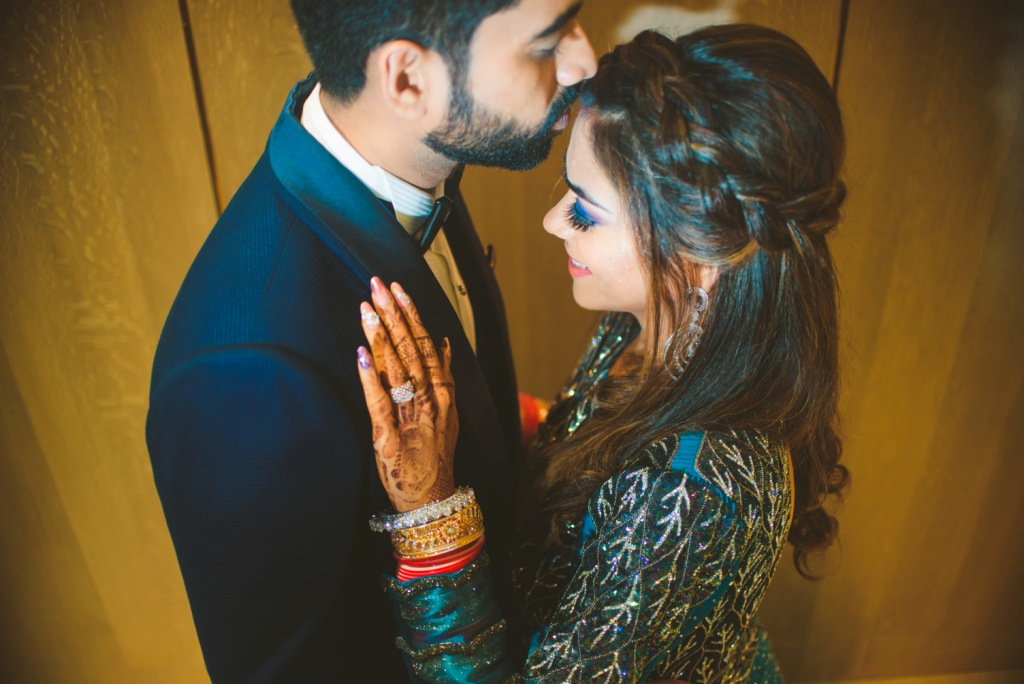 An adorable click from Pooja and Mohit's english themed reception of their Karjat destination wedding