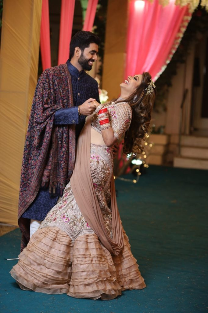 Pooja and Mohit posing for the reception shoot of their Karjat destination wedding
