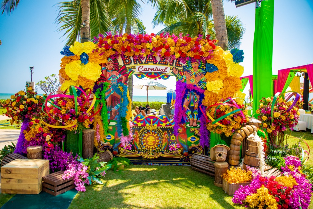 Colorful Carnival Theme Floral Pool Party Photo-booth Decor for Swati & Saket's Indian Destination Wedding in Thailand