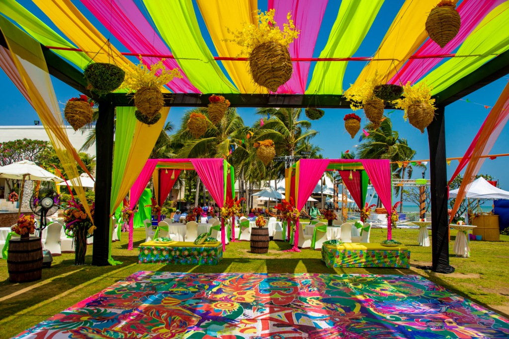Colorful Draped Outdoor Pool Party Setup with Hanging Flower Nests in Swati & Saket's Indian Destination Wedding in Thailand