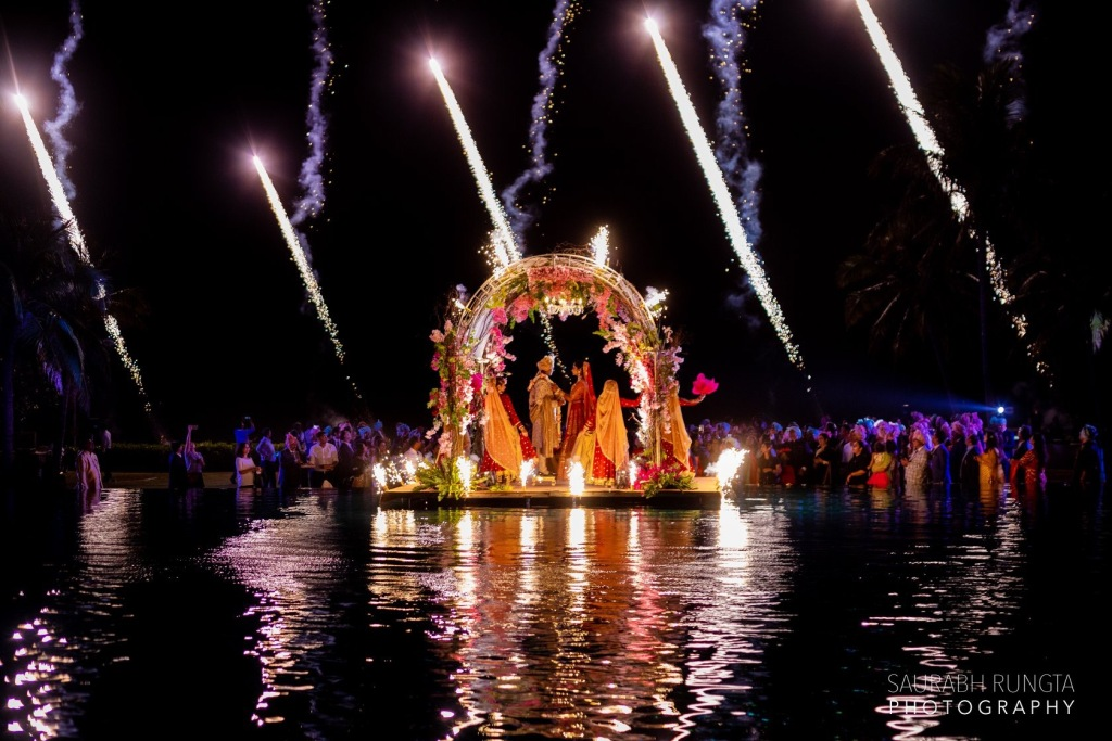 Beautiful Indian Destination Wedding in Thailand Picture with Fireworks Show During Jaimala