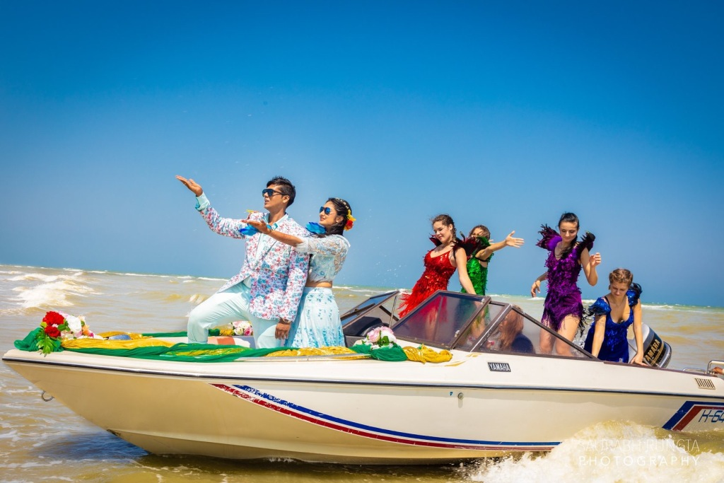 Bride & Groom's Entry in a Boat for Pre Wedding Pool Party of their Indian Destination Wedding in Thailand