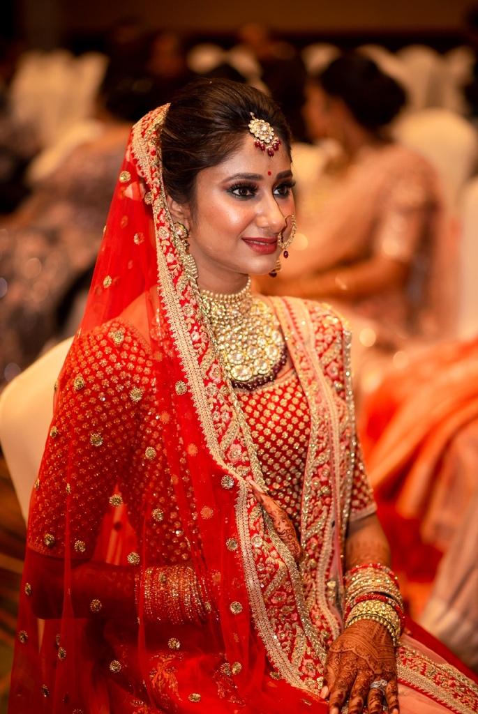 Swati in Red Sabyasachi Lehenga and Matching Kundan Jewelry