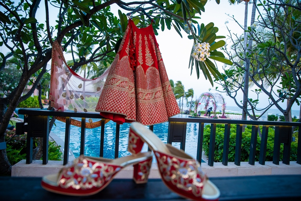 Sabyasachi Bridal Lehenga and Matching Red Bridal Sandals' Shot