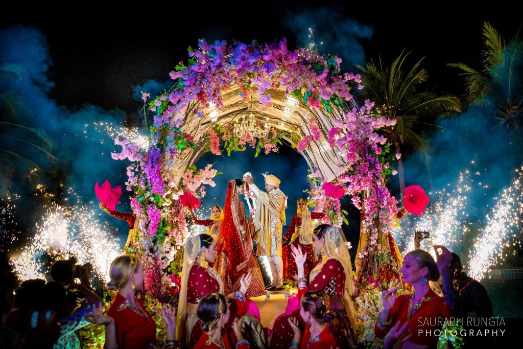 Jaimala Ceremony Under a Floating Floral Arch at the Indian destination wedding in Thailand