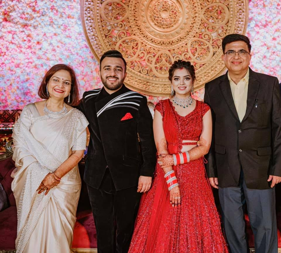 Family Picture from Wedding Reception from Mayfair Raipur Wedding