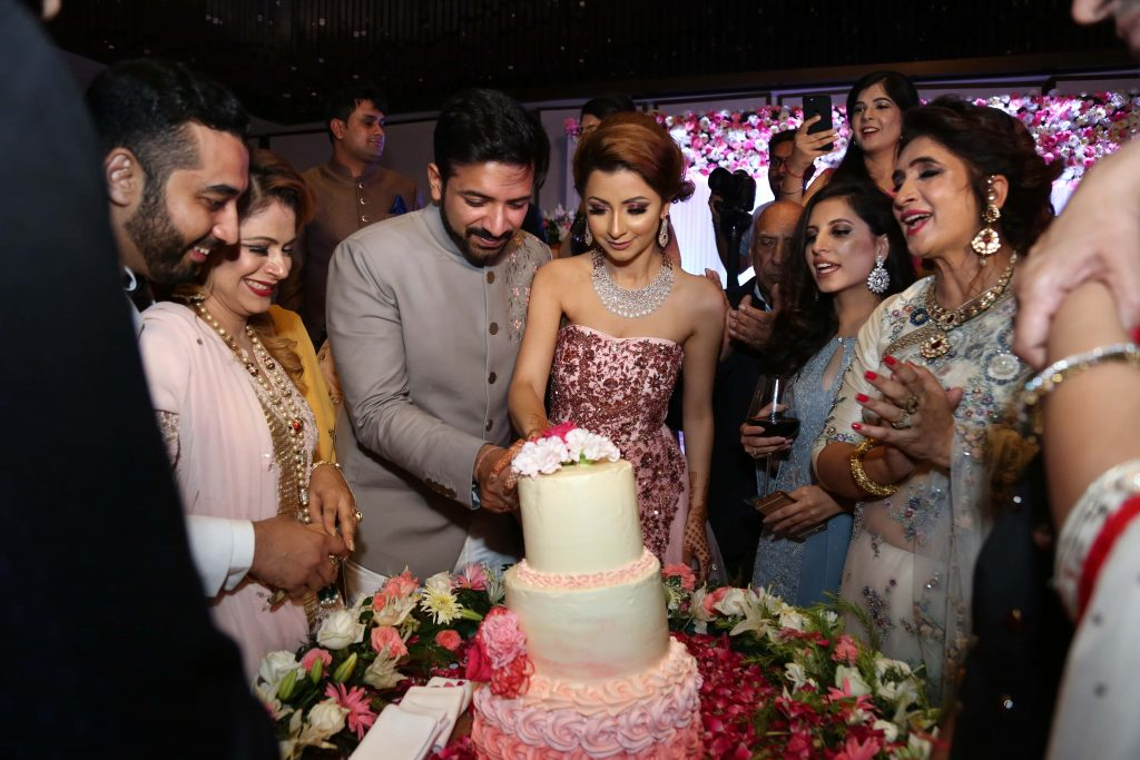 Kanika and Saurav cutting cake post their engagement ceremony in Delhi