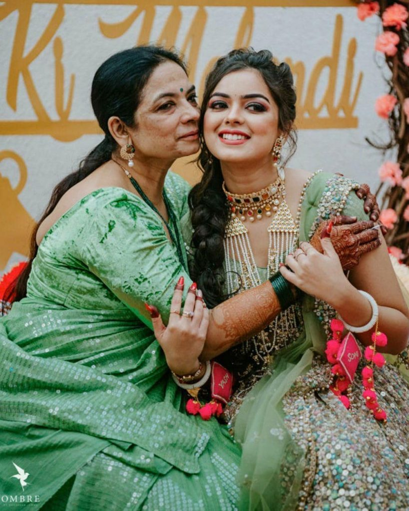 Bride Somi's Candid Picture with her mother both coordinating in sea green outfits in the Mayfair Raipur Wedding