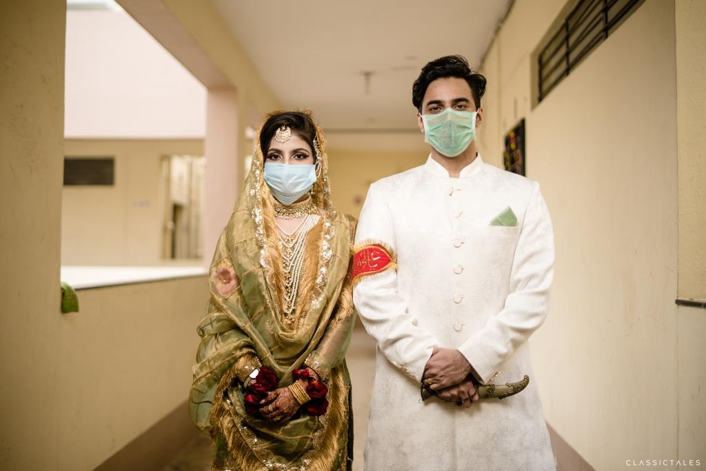 Bride & Groom posing in Masks at their Intimate Wedding in Lockdown