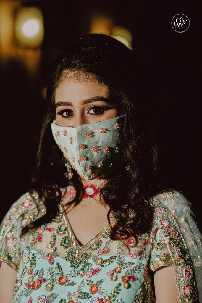 Ayushi in powder blue outfit for her mehendi ceremony with matching embellished mask