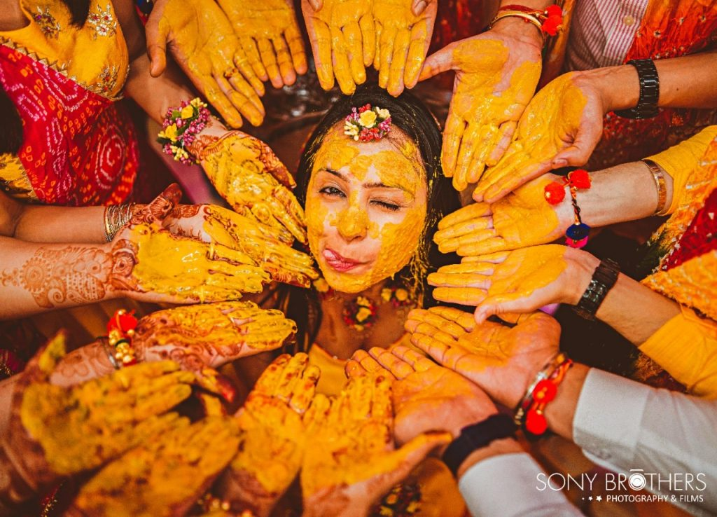 Fun click at the Haldi Ceremony of Sakshi & Royal's one of the most beautiful Intimate Weddings in Lockdown