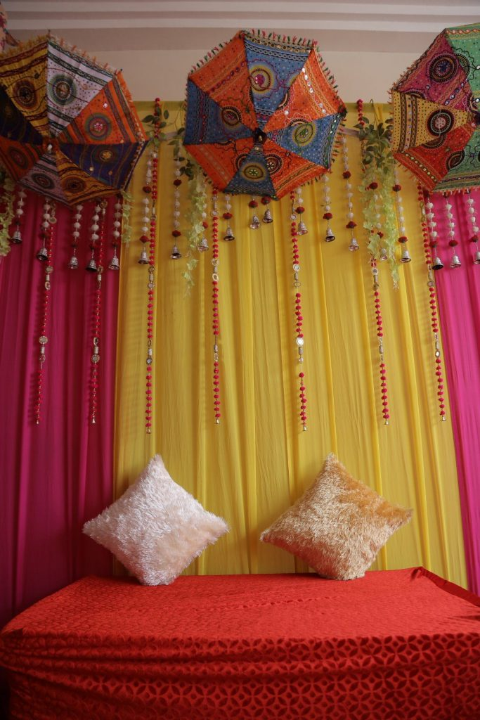 Suhani and Vastav's Simple Wedding Decoration at Home with Colorful Curtains and Umbrellas