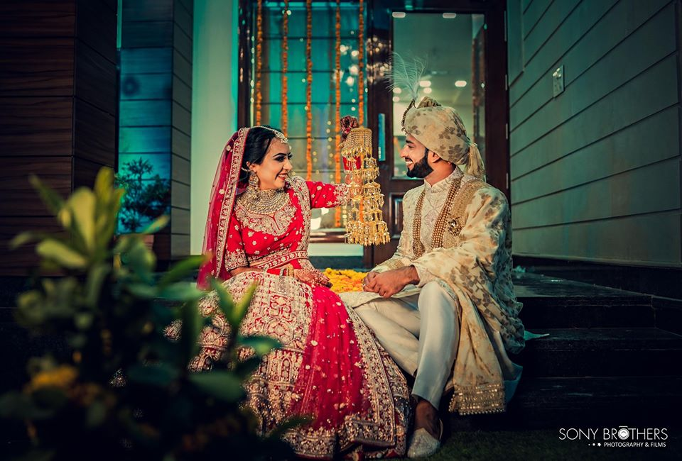 Sakshi & Royal's candid portrait post wedding picture