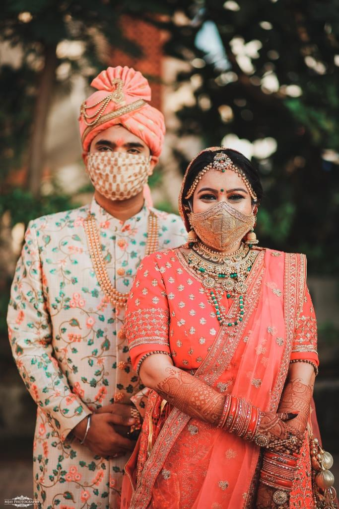 Riddhi and Ronak adorned in designer wedding outfits with masks at their intimate wedding in lockdown