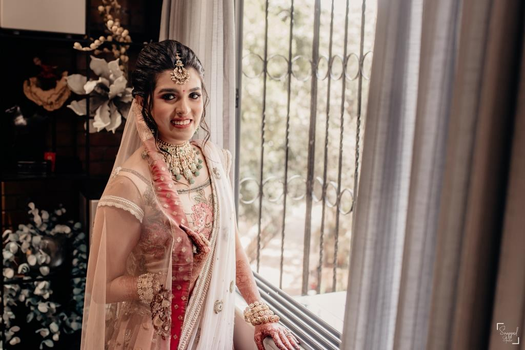 Shreya embellished in beautiful peach bridal lehenga and complimenting jewellery set for her home wedding ceremony during lockdown