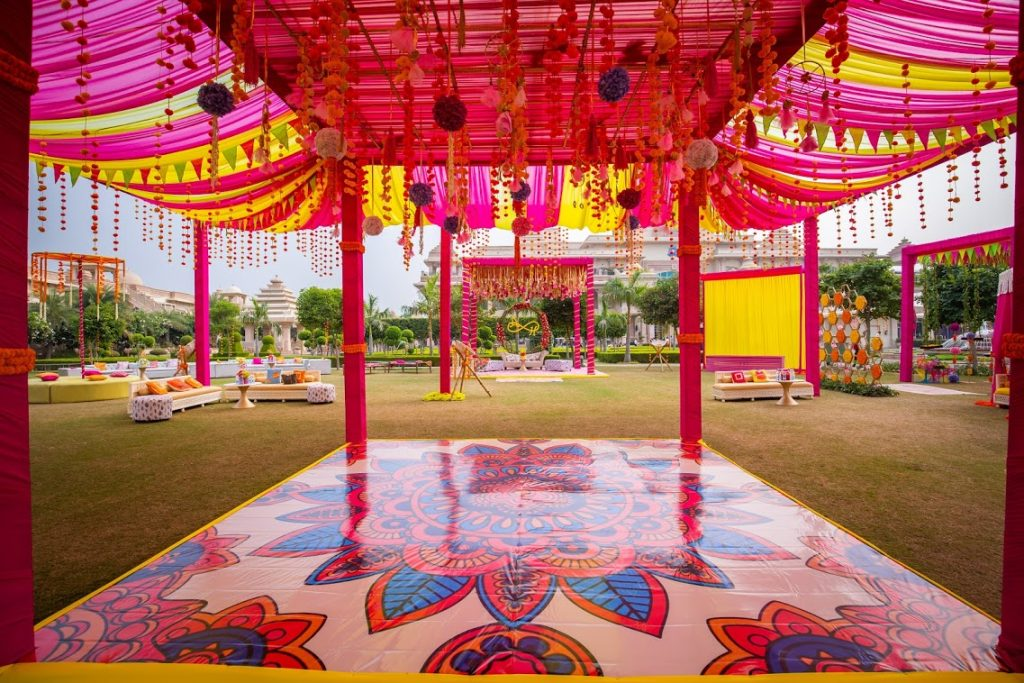 Colourful and Pink Mehendi Function Decor for ITC Grand Bharat Wedding
