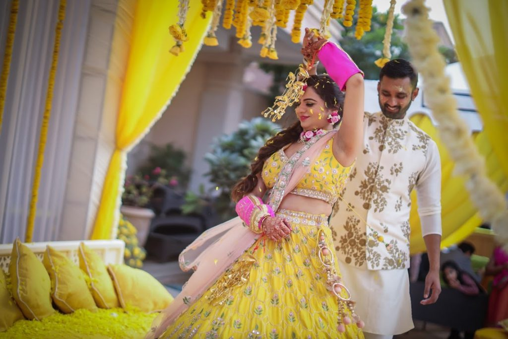 Aakriti and Hitesh complementing each other in White and Yellow for their Haldi at ITC Grand Bharat, Gurgaon