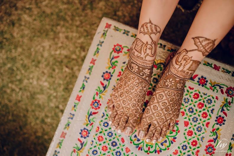 Akansha's beautiful bridal mehendi on feet for her Royal Marwari Destination Wedding