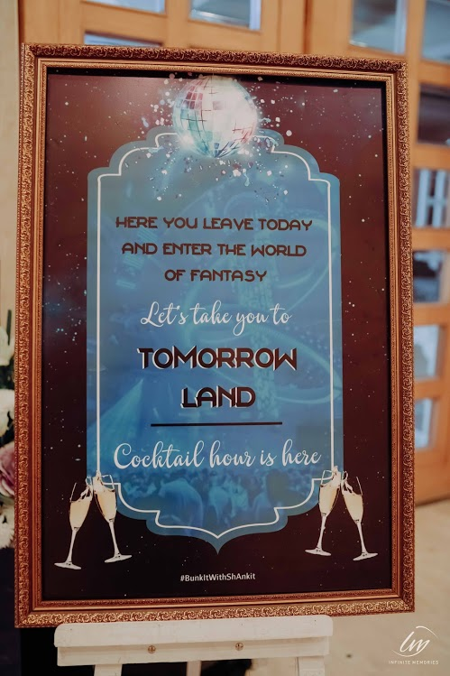 Beautiful Tomorrow Land Themed Cocktail Party Signboard for this Royal Marwari Wedding