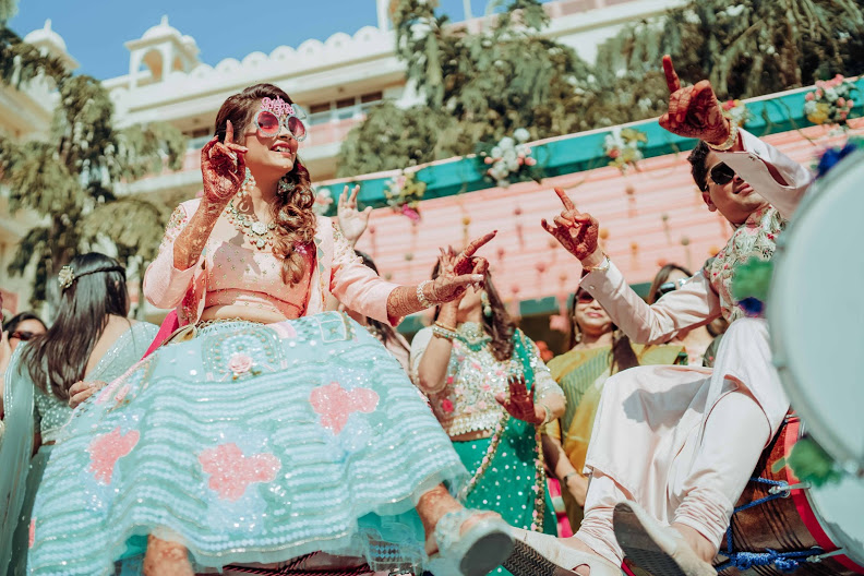 Akansha & Ankit having the best time at their Jaipur Destination Wedding's English Carnival at Le Meridien Jaipur