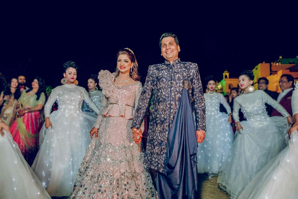 Royal Marwari Wedding's Fantastic Couple Entry with Dancers wearing costumes with LED lights