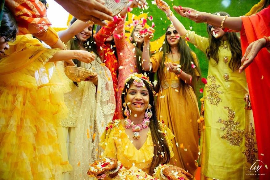 Beautiful Flower Shower Moment captured from Royal Marwari Wedding