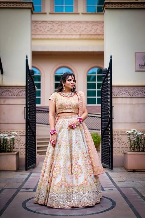 Aakriti looking phenomenal in her exquisite peach and white embroidered lehenga for her ITC Grand Bharat Wedding's Mehendi Function