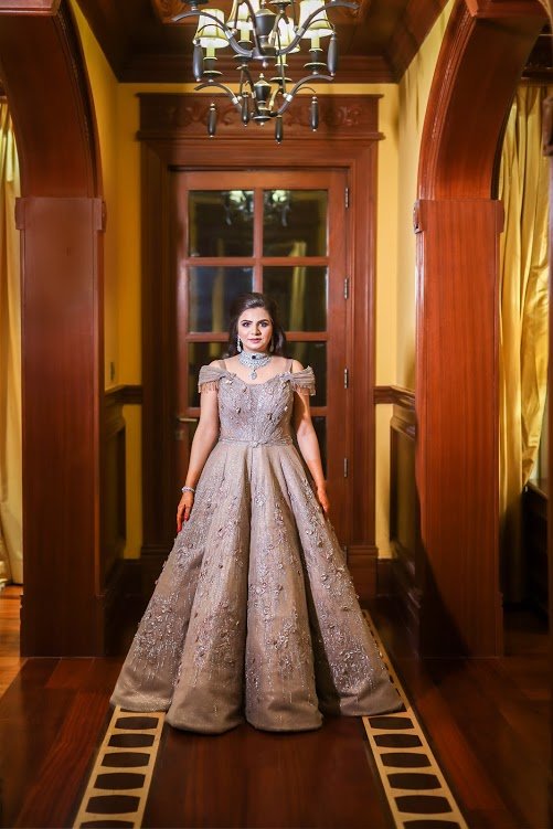 Aakriti looking like a Disney princess in her shimmering golden Sulakshana Monga Cocktail gown at her ITC Grand Bharat Wedding Cocktail Party