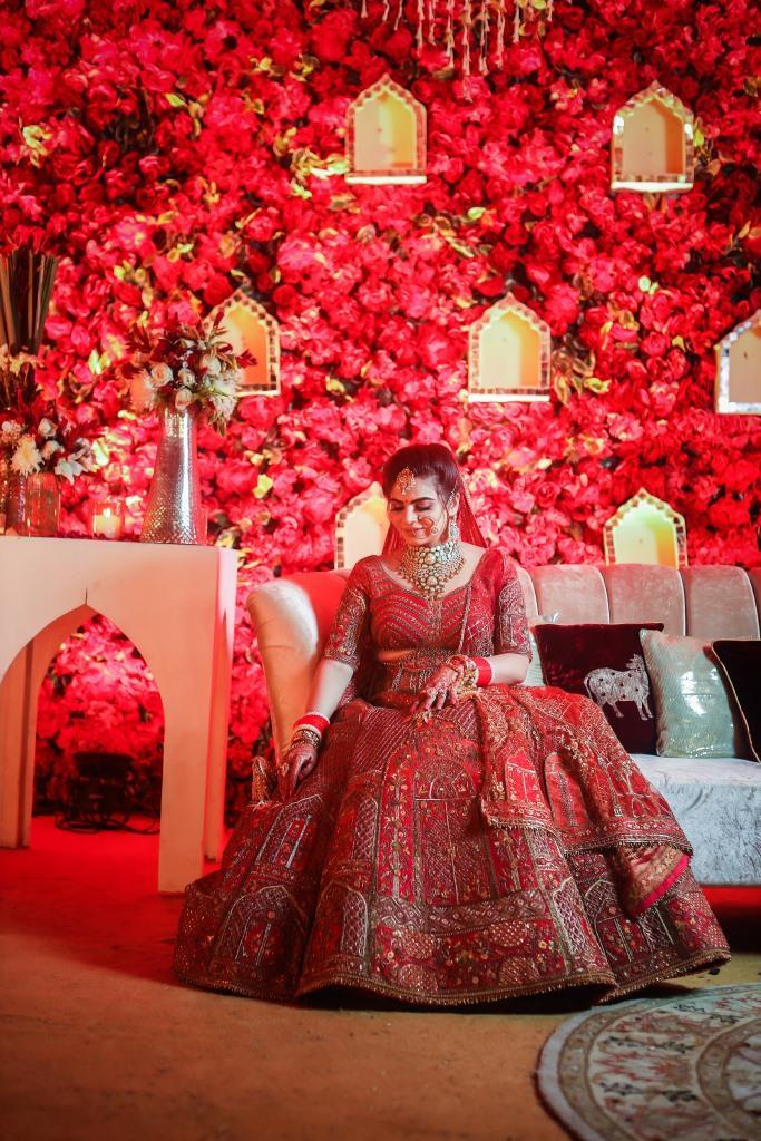 Aakriti looking mesmerising in her red Sulakshana Monga lehenga at her ITC Grand Bharat Wedding