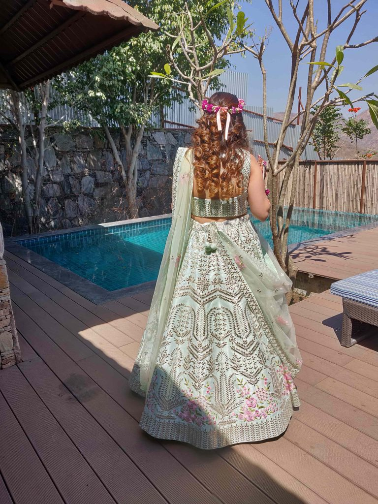 Bride Pooja in powder blue engagement lehenga & highlighted tight curls hairstyle with a floral tiara giving beautiful bridal hairstyle ideas for an engagement ceremony