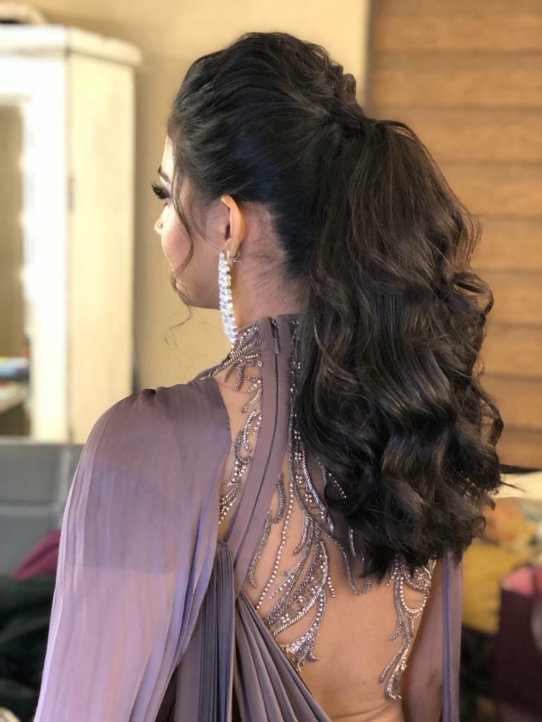 Front puffed high wavy ponytail Indian bridal hairstyle for cocktail ceremony