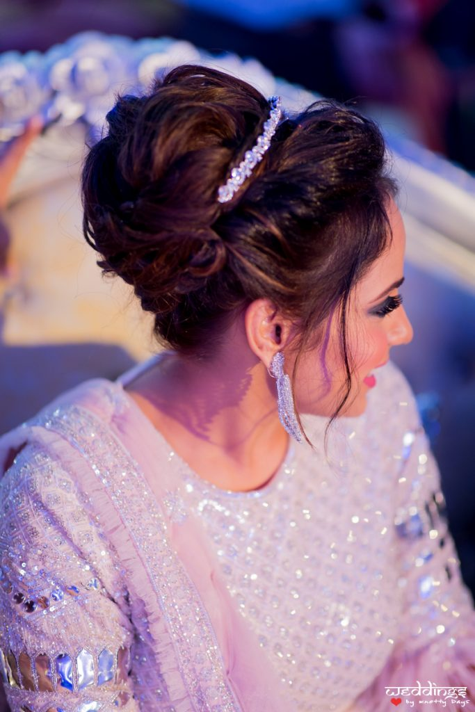 Bride Shalini in silver sangeet ceremony outfit & voluminous messy updo with crystal hair accessories