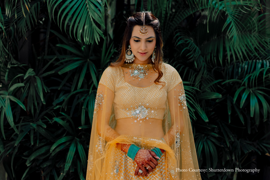 Priyanshi in yellow mirror work lehenga, bahubali earrings & two side puff hair style