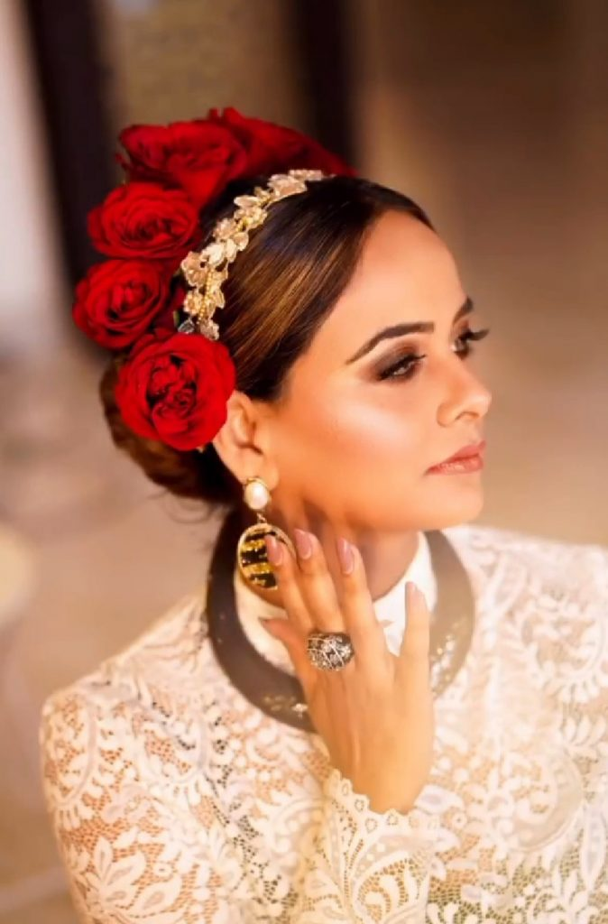 Sabyasachi inspired bridal hairstyle ideas with a sleek bun, Swarovski hair accessories & red rose headband