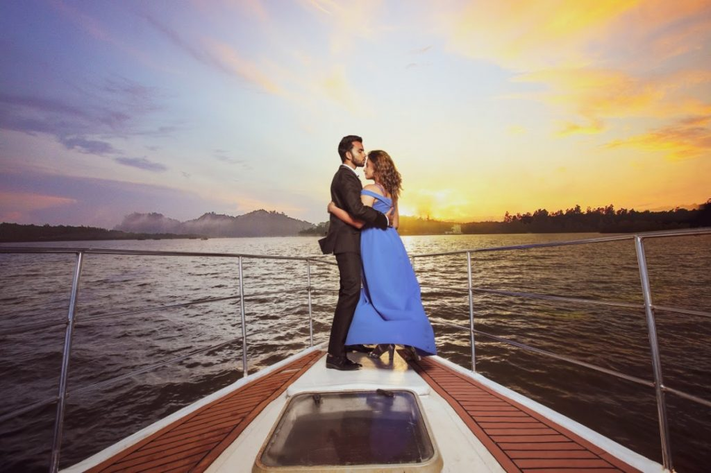 Stunning Pre-wedding Portrait of Nishtha & Granth on a Boat with Sunset Backdrop captured before their royal Crowne Plaza Gurgaon Wedding