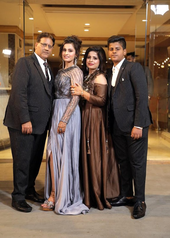 Lovely Portrait of Nishtha with her family at the smashing Cocktail Party at Seven Seas before Crowne Plaza Gurgaon Wedding