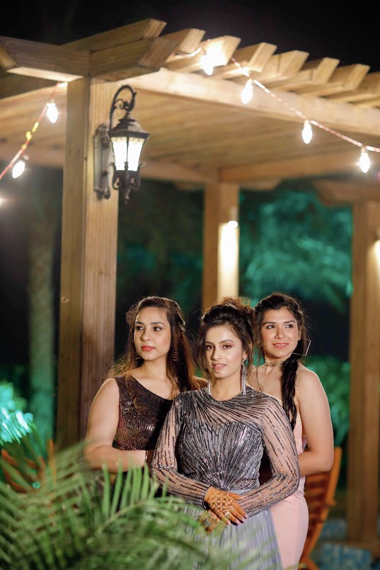 Beautiful Portrait Shot of Nishtha with her bridesmaids from her Poolside Cocktail Party at Seven Seas