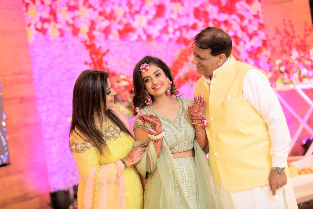 Lovely Portrait of Nishtha with her parents at Symphony Banquets for her Haldi