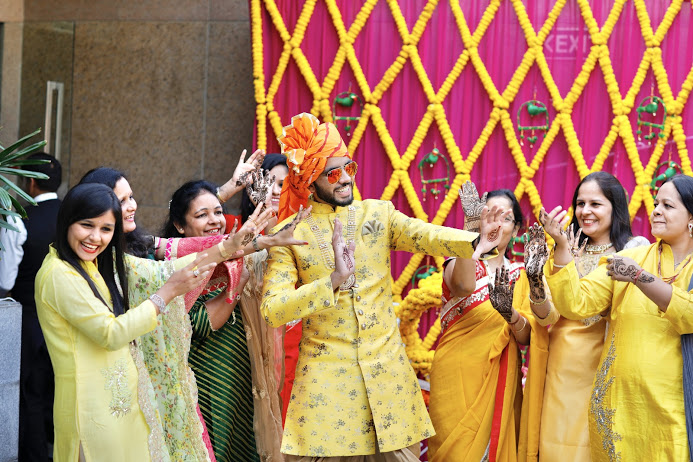 Fun Photoshoot of Groom with Family at Haldi Function at Crowne Plaza, Gurgaon