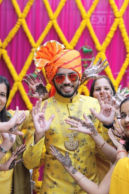 Granth rocking yellow Manyavar ethnic piece at his Crowne Plaza Gurgaon Wedding's Haldi Party