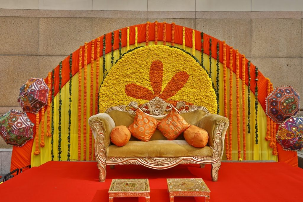All Yellow Floral Haldi Stage Decor at Granth's Haldi Function at Crowne Plaza, Delhi