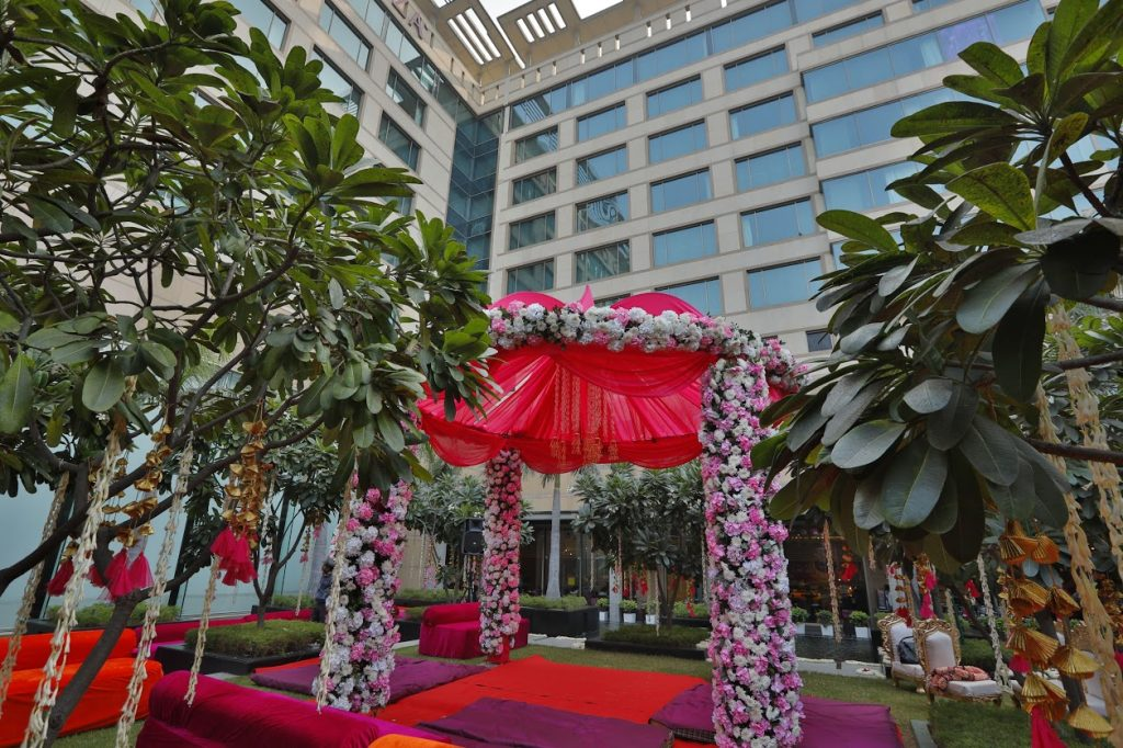 Most Beautiful Pink and White Floral Mandap Decor for this grand wedding at Crowne Plaza, Delhi