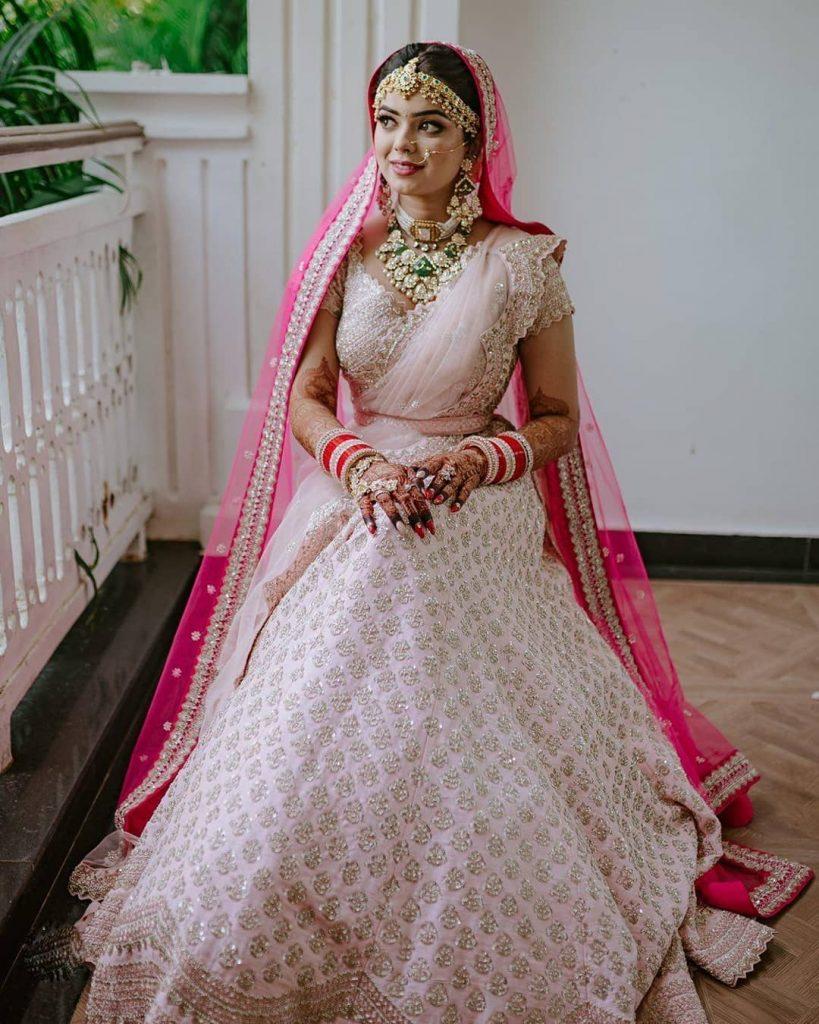Beautiful Bride Somi's Solo portrait in her pink wedding lehenga & beautiful soft pink makeup look