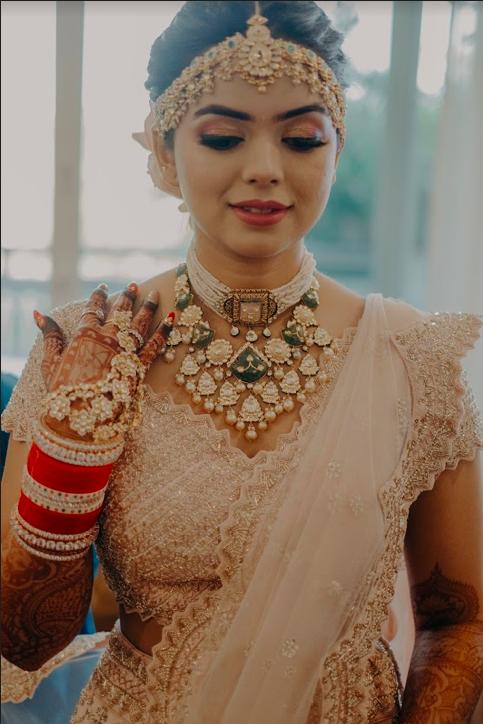 Bride Getting ready for her destination wedding at Mayfair Lake Resort in Raipur