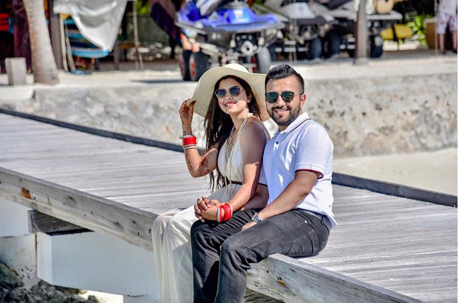 Somi & Yash in smart yet casual wear relaxing at their Honeymoon in Maldives post wedding at Mayfair Lake Resort in Raipur