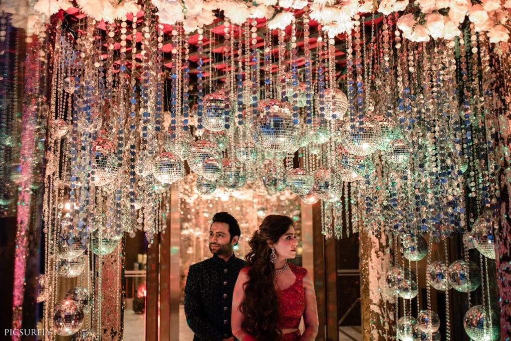 Beautiful Sangeet Portrait of Harsha & Kunal captured at JW Marriott Juhu with majestic decor incorporating disco balls and candle lights