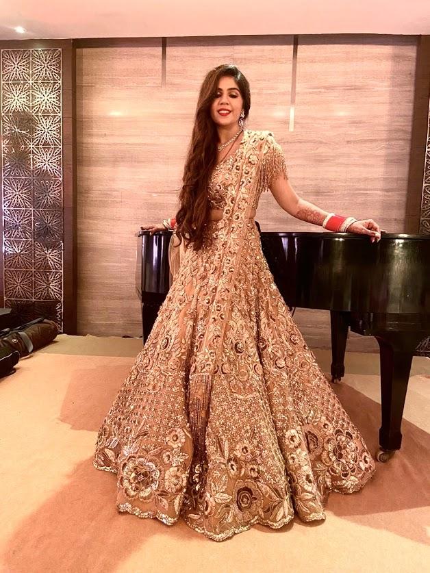 Harsha rocking Manish Malhotra golden lehenga at her wedding reception at JW Marriott Juhu Mumbai