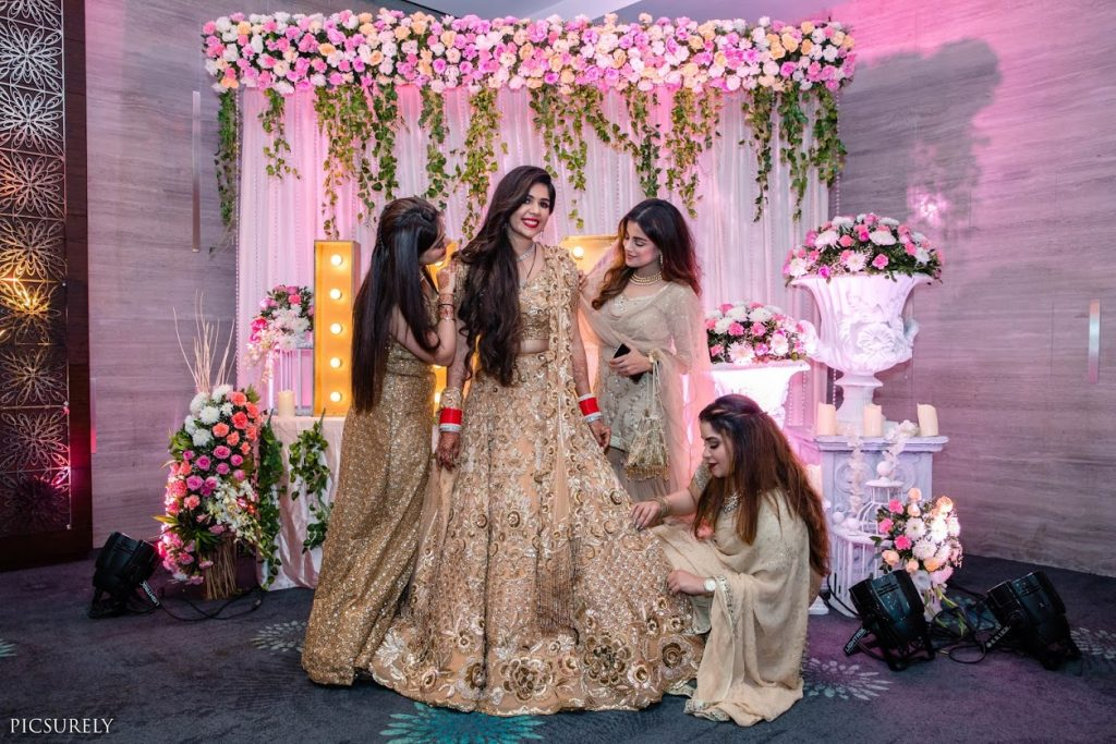 Coordinated Golden Outfits for Reception at this Sea Princess Juhu Wedding